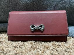 Coach x Selena Trifold Phone Case With Crystal Embellishment